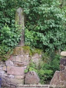 cross in wall at Alport